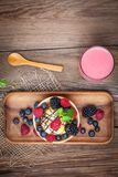 Tasty ice cream dessert with fruit in a waffle bowl. Top view Stock Photo