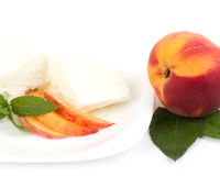 Tasty ice cream dessert with peach Stock Images