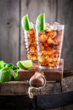 Tasty iced tea with ice cubes and mint Stock Images