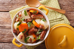 Tasty Irish coddle with pork sausages, bacon and vegetables in a Royalty Free Stock Image