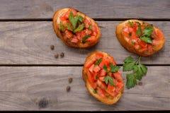 Tasty Italian bruschetta with tomato and herbs Royalty Free Stock Photo
