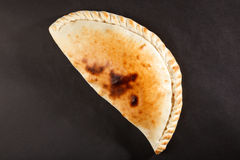 Tasty Italian closed pizza calzone Royalty Free Stock Image