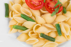 Tasty italian pasta with tomato as haute cuisine. Royalty Free Stock Images
