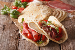 Tasty Italian piadina stuffed with ham, cheese and vegetables cl Royalty Free Stock Image