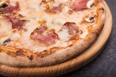 Tasty italian pizza with bacon and mushrooms Royalty Free Stock Image