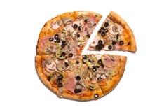 Tasty Italian pizza with ham, one slice removed Stock Photos
