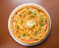 Tasty Italian pizza  with lemon Stock Images