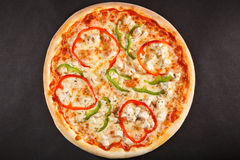 Tasty Italian pizza with pepper sweet cheese and chicken Royalty Free Stock Images