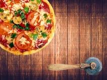 Tasty Italian pizza on wooden table stock photos