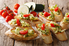 Tasty Italian sandwiches with zucchini and tomatoes close-up and Stock Image