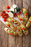 Tasty Italian sandwiches with zucchini and tomatoes close-up and Stock Photos