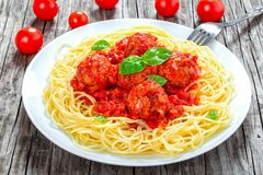 Tasty italian spahgetti with meatballs and tomato sauce, close-up Stock Images