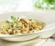 Tasty italian tagliatelle with parmesan cheese and pine nuts Royalty Free Stock Photography