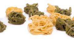 Tasty italian tagliatelle pasta. On a white background Royalty Free Stock Photography