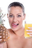 Tasty juice of pineapples. Thirsty woman holding glass of pineapple juice and licks his lips Royalty Free Stock Images