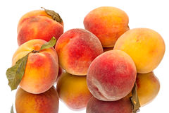 Tasty juicy peaches  on white Stock Photography