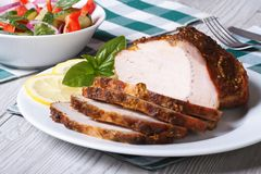 Tasty juicy roast pork tenderloin and salad on the table Stock Photos