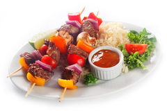 Tasty Kebabs on Plate with Rice, Sauce and Veggies Stock Image