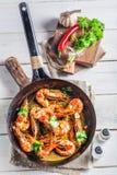 Tasty king prawns served on hot pan Royalty Free Stock Image