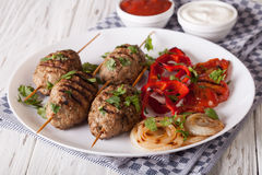 Tasty kofta kebab with grilled vegetables on a plate. horizontal Royalty Free Stock Photo