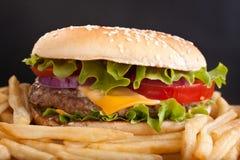 Tasty Large Cheeseburger Royalty Free Stock Photos