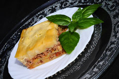 Tasty lasagne with basil leaf. Traditional beef lasagne with beschamel stock photography