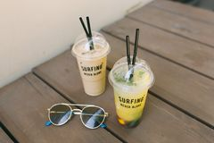 Tasty lemonade with fruts, ice latte and sunglasses at the table. Lemonade with fruts, ice latte and sunglasses at the table Stock Photography