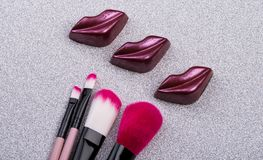 Tasty lips and makeup brushes stock image