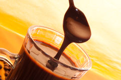 Tasty liquid chocolate on glass Stock Photography