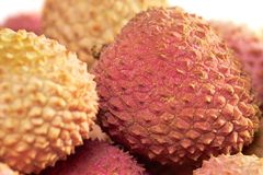 Tasty litchi. Isolated on the white background Stock Photos