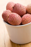 Tasty litchi fruit in ceramic bowl Stock Image
