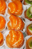 Tasty little tarts with tangerine Stock Image
