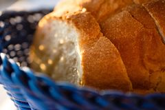 Tasty Loaves Of Traditional Homemade Bread In Blue Wooden Basket. A close-up shot of tasty loaves of traditional homemade bread in a blue wooden basket stock photo