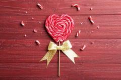 Tasty lollipop on color background. Tasty lollipop on color wooden background Stock Photo