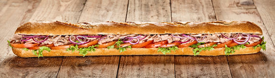 Tasty long tuna and fresh salad baguette Royalty Free Stock Images