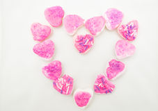 Tasty looking cookies with pink frosting shaped Royalty Free Stock Photography
