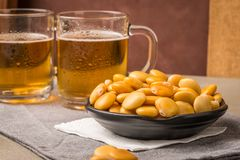 Tasty lupins and glass of beer Royalty Free Stock Photography