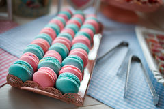 Tasty macarons color of mint and pink on beautiful tray. Sweet colorful macarons for the wedding guests Royalty Free Stock Photos
