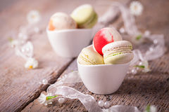 Tasty macarons in little cups Royalty Free Stock Photography