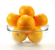 Tasty mandarines in bowl Stock Photo