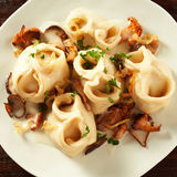 Tasty manti or mantu pasta served with mushrooms Royalty Free Stock Photo