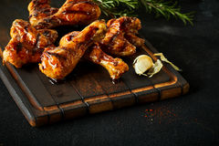 Tasty marinated chili chicken wings and legs Stock Photos