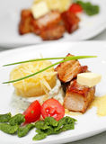 Tasty meal with pork, potato and vegetables Stock Images
