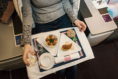 Tasty meal served on board of airplane on the table. stock photos