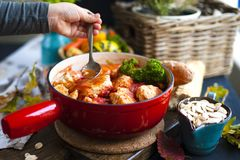 Tasty meat balls from beef and pork in tomato sauce, Autumn meal at home. Copy space.  royalty free stock images