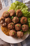 Tasty meat balls Bitterballen and mustard close up on a plate. v Stock Image