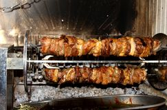 Tasty meat cooked in the fireplace with the spit 2 Stock Photo