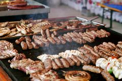 Tasty meat on the grill. Tasty meat on barbecue grill with coal.Delicious, barbeque royalty free stock image