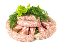 Tasty meat. Pieces of Pork and Sausages Royalty Free Stock Photo