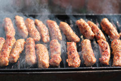 Tasty Meat Roasted On A Grill Stock Photos